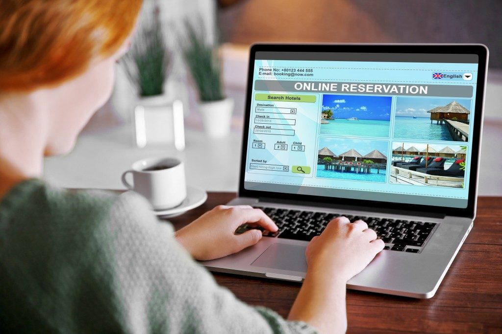 woman booking a hotel room reservation