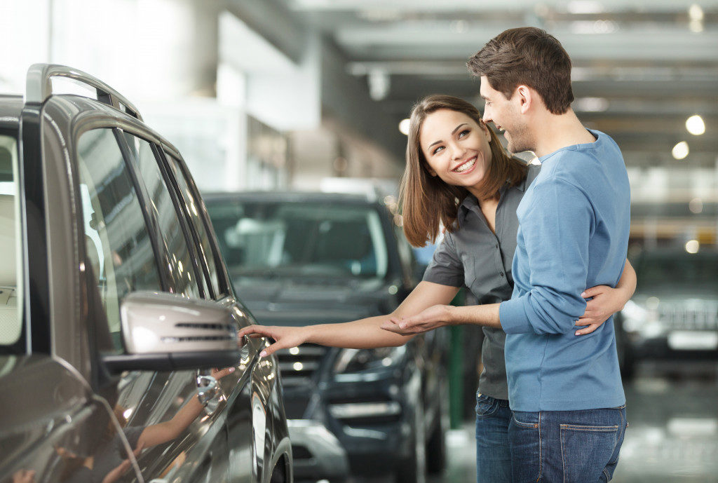 Couple looking at a new car